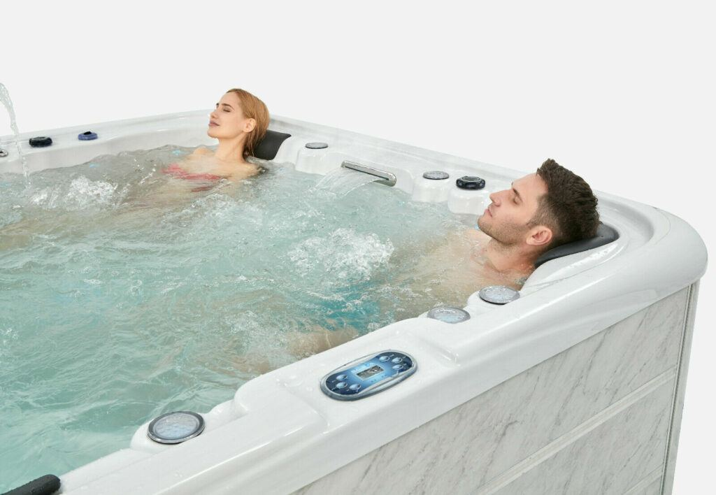 People bathing in hot tub image