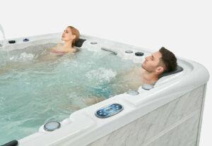 People bathing in hot tub image